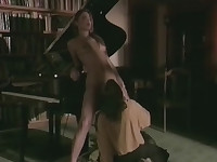 Couple having sex at the piano